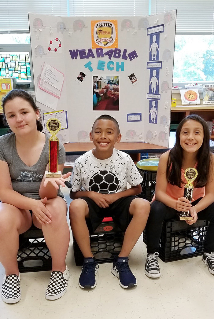 Lake Shore Elementary fifth-graders Ana Moore and Grace Booth and fourth-grader Darnell Witten were on the Wearable Technology team.