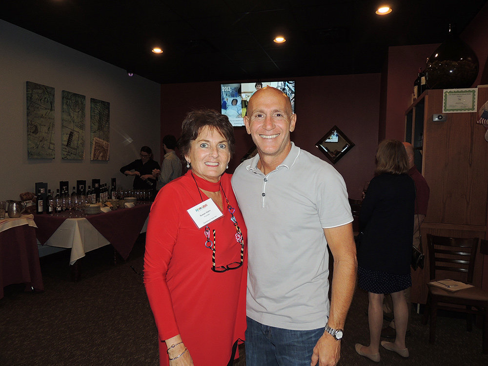 HobbleJog founder Susan Hahn and La Posta owner Charlie Priola were happy to see community members come out to support a good cause at the Taste of Italy fundraiser.