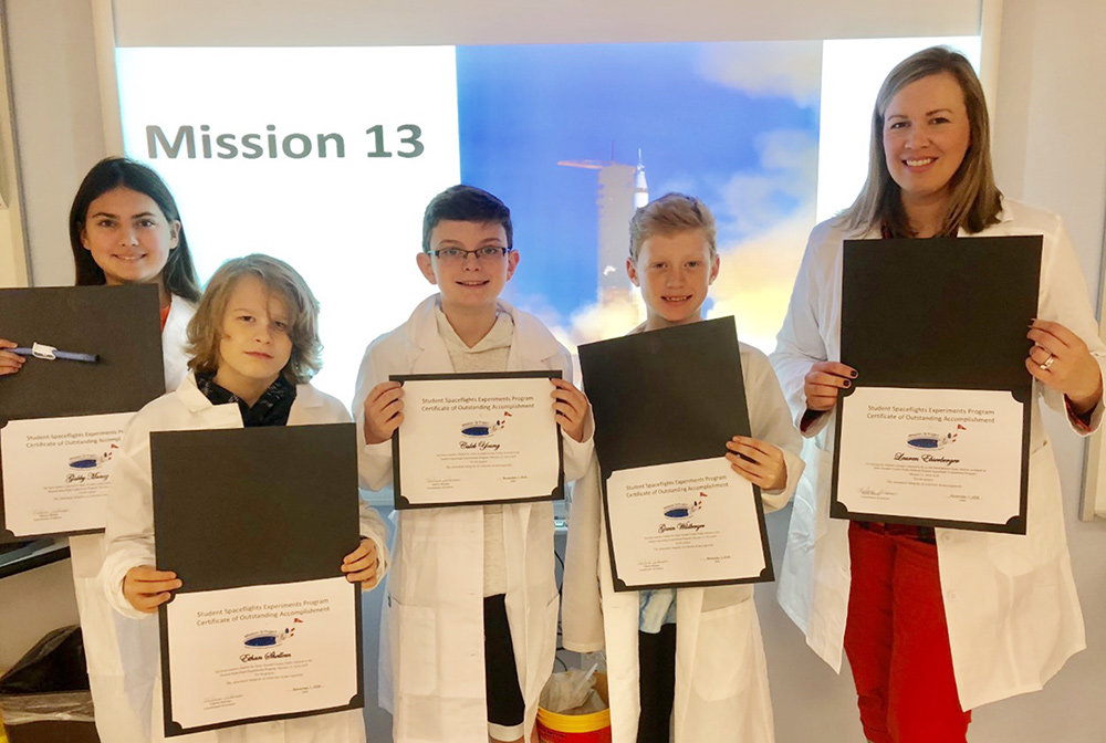 MRMS sixth-graders Caleb Young, Ethan Shellem, Gavin Wildberger and Gabby Munoz created a project that will be sent into space in July.