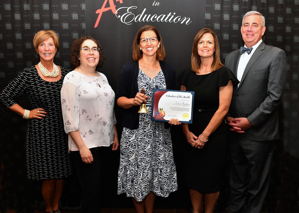 Julie Butler (middle) was recognized as the Anne Arundel County Public Schools (AACPS) Volunteer of the Month in June.