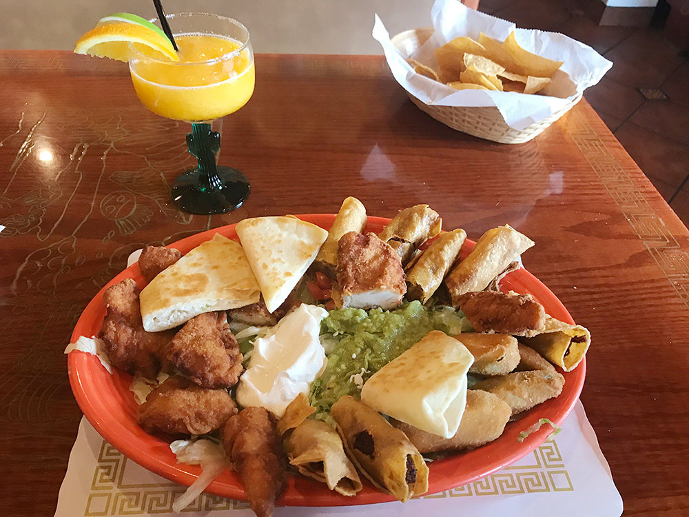 The botana mixta includes a cheese quesadilla, taquitos, chicken fingers and jalapeno poppers served over a bed of lettuce, guacamole and sour cream.