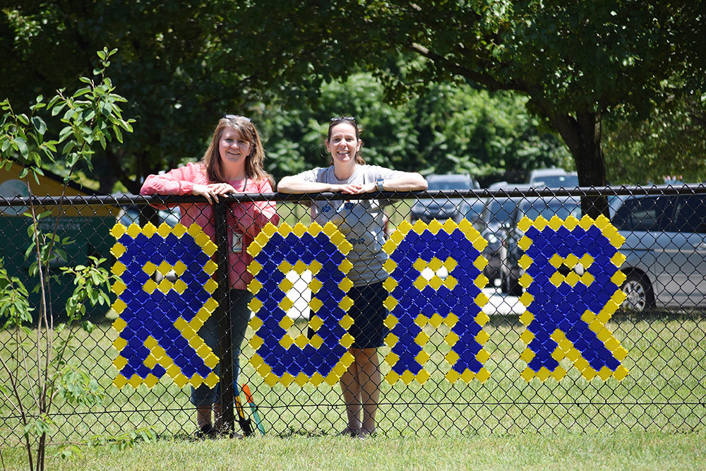"Laura Walton (left) and Jacobsville Elementary Principal April Umile (right) posed with the ""Jaguars Roar"" message at the entrance to the school."