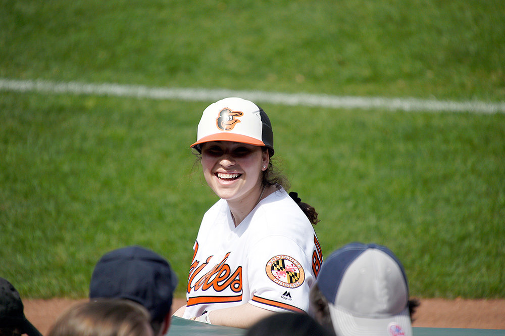 As a ball girl for the Baltimore Orioles, Abby Becker retrieves foul balls, runs scripts with the MASN crew before broadcasts, helps with the ceremonial first pitch, and interacts with the crowd.