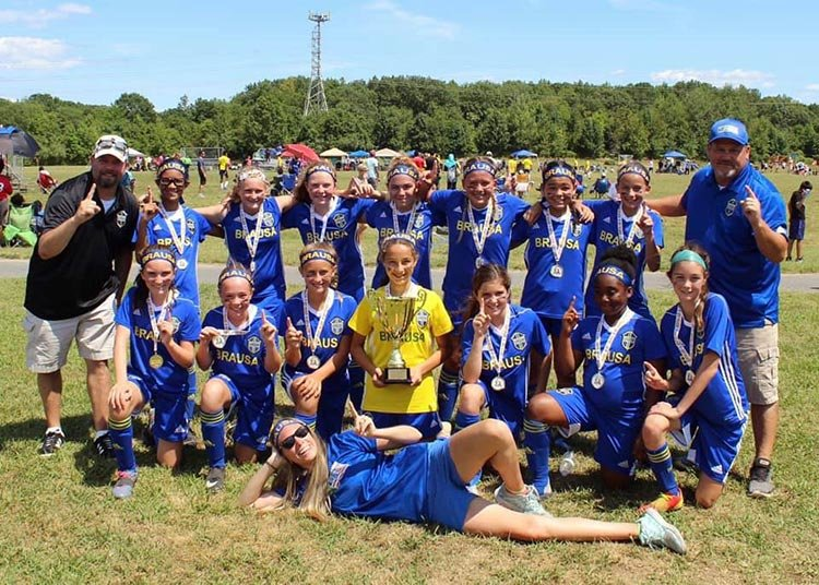 The Brausa '07 girls soccer team went 3-0-1 to claim the championship at the Overlea Cup this August.