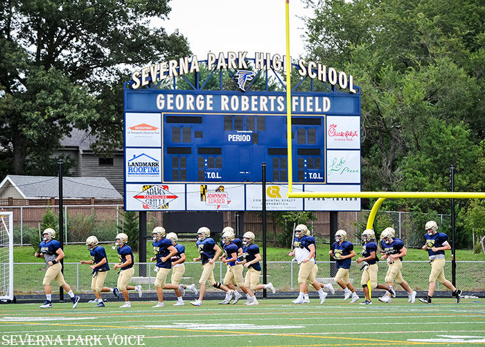 The Severna Park football team ran a warmup lap prior to practice on August 27. The Falcons open the season against North County at home on September 6.