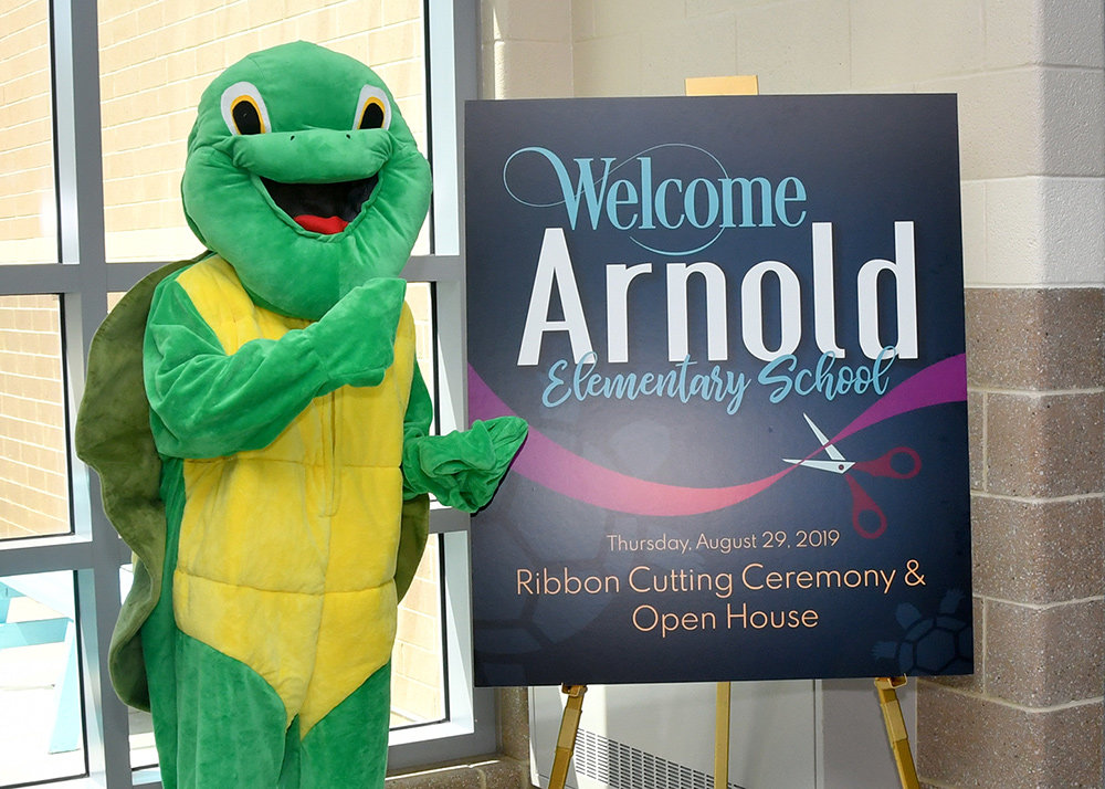 Arnold Elementary students and staff were joined by AACPS officials and politicians during the Arnold Elementary ribbon cutting on August 29.