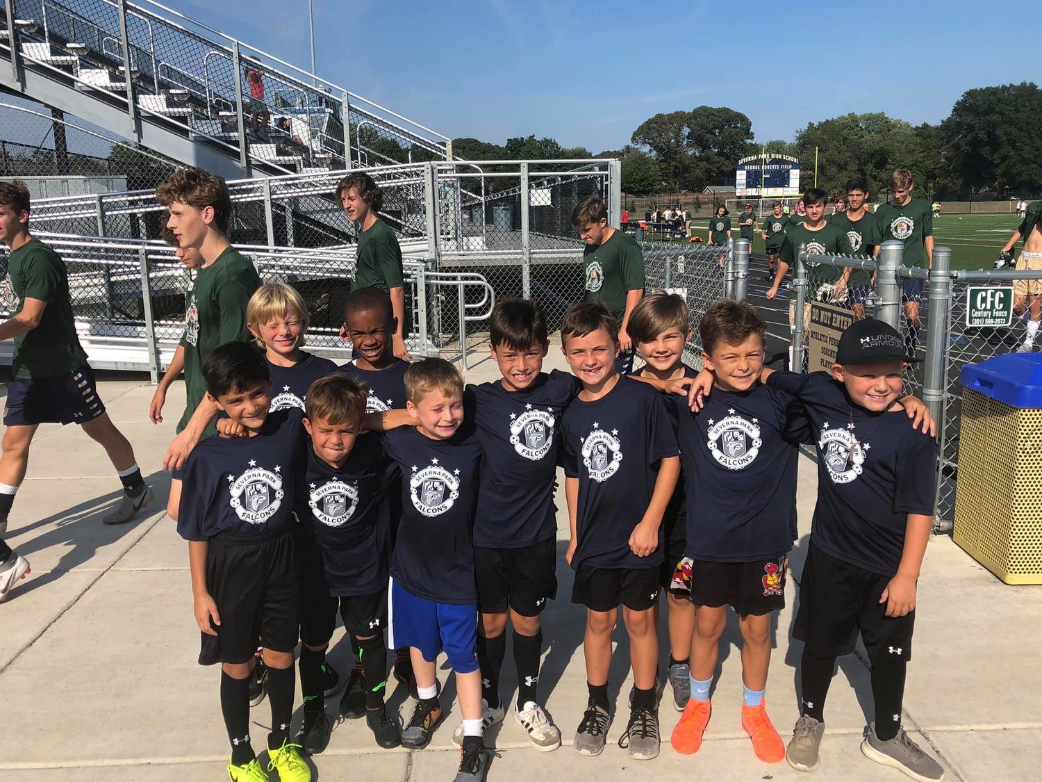 The Green Hornets took part in introductions and served as ball boys for Tuesday's varsity game against Northeast, won by the Falcons 1-0.