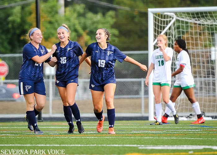 Bella Espinoza (16) celebrated with teammates Ella Raines and Chloe Nagel (19) after her second goal of the game put Severna Park up 3-0 in the Falcons' 3-0 win over Arundel on September 26.