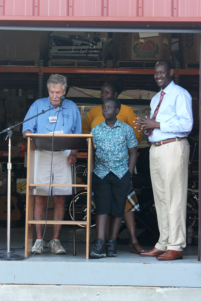 Theil Theil (far right), one of the Lost Boys of South Sudan, gave a passionate speech about overcoming poverty and tragedy.