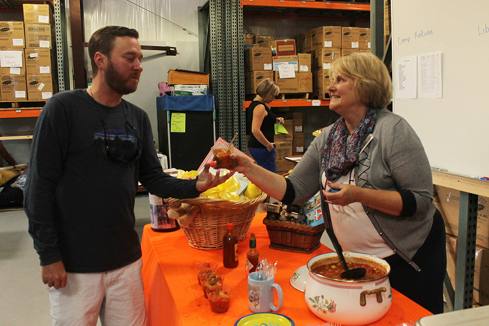 OGT volunteer Linda Zahn (right) served shrimp gazpacho to event attendees.