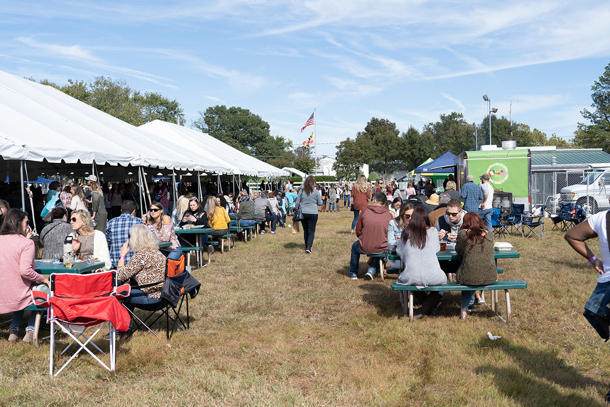 Guests sat at picking tables enjoying food and wine from local vendors.