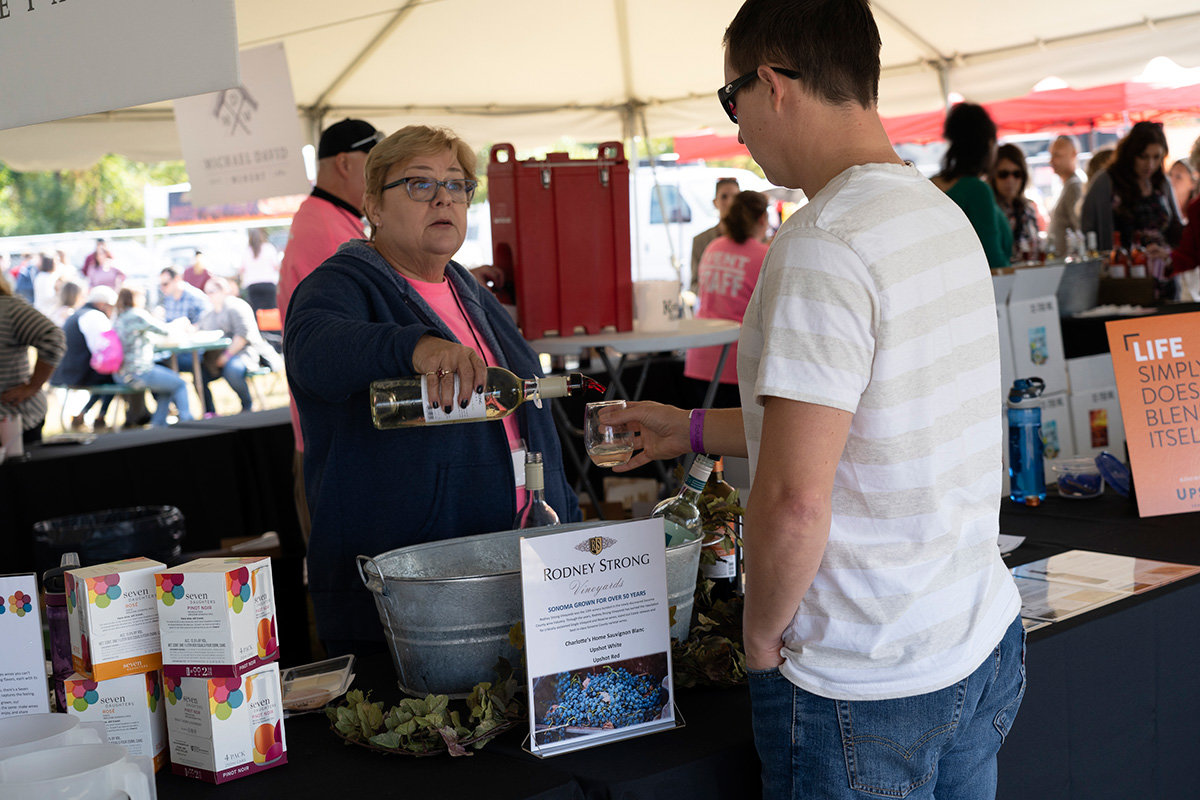 A representative from Rodney Strong Vineyards poured wine for a guest.