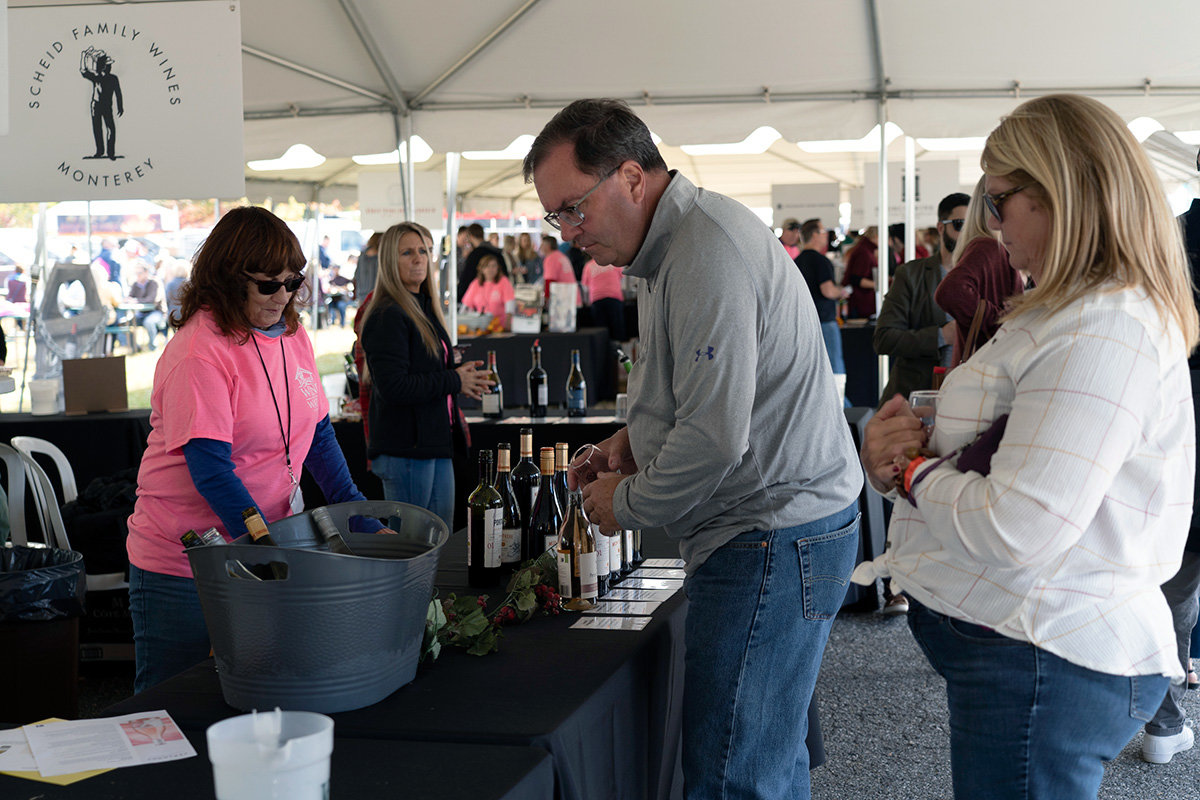 A man decided which wine to try during the festival on October 19.