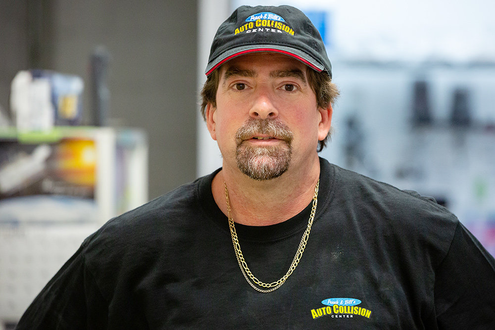 Tom Novotny, an I-Car platinum-certified refinish technician, began his training in vo-tech and has been with Frank & Bill's for 16 years.