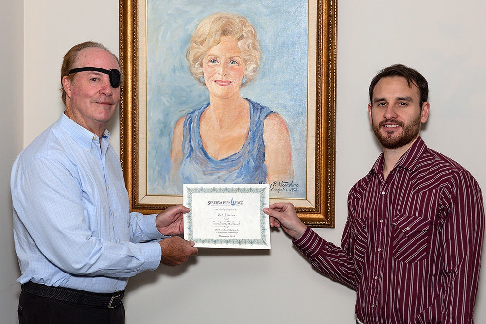Ted Florenz received the December Volunteer of the Month certificate from Severna Park Voice Editor Zach Sparks.