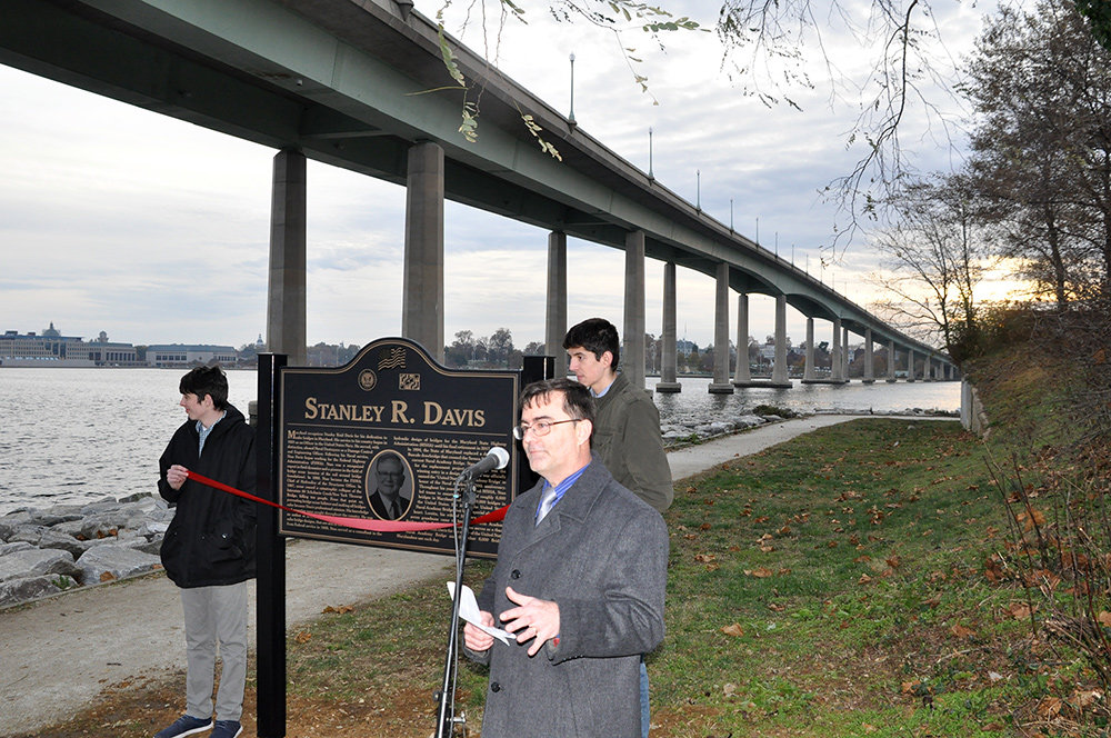 Mark Davis spoke about his father, Stan Davis, while a crowd gathered at the new plaque at Jonas and Anne Catharine Green Park, located in the shadow of the United States Naval Academy Bridge.