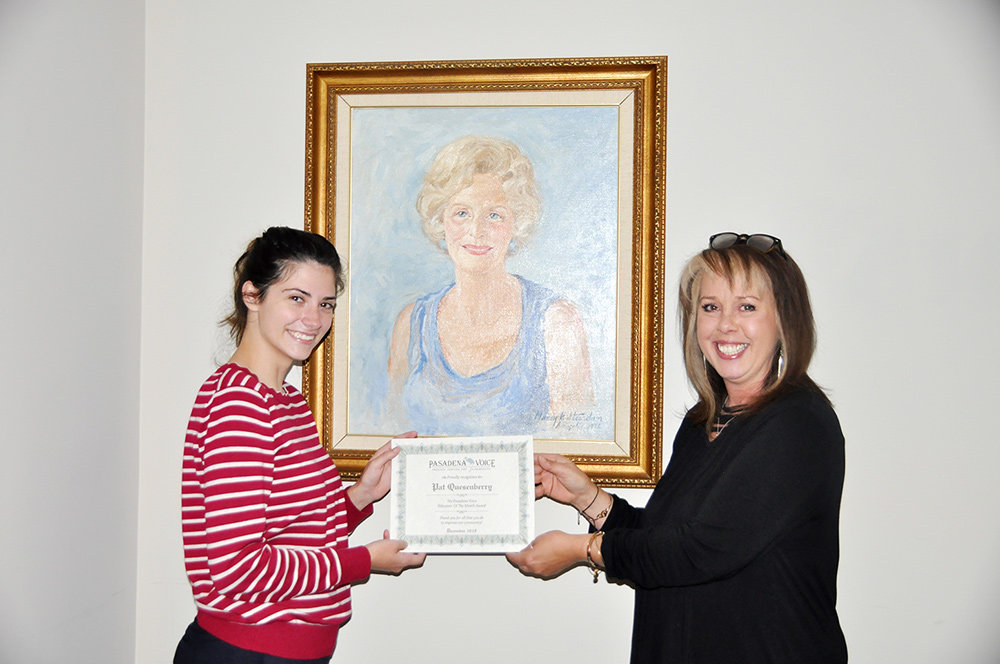 Pat Quesenberry (left) received her Volunteer of the Month award from editorial assistant Haley Weisgerber.