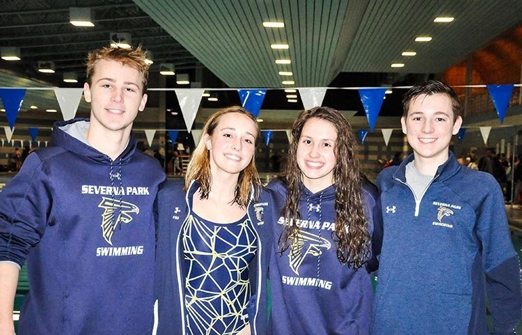 Team captains (l-r) Colin Dennis, Emma Patenaude, Lauren Turk and Ben Simpkins led the Falcons in their quad meet victories on January 10.