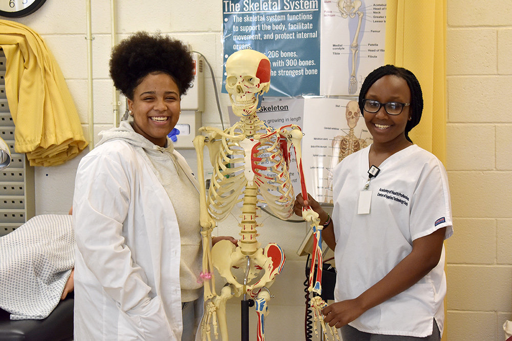 Cailyn Dove (left) and Grace Kinuthia of Broadneck High School are in the first level of the two-step Academy of Health Professions program.