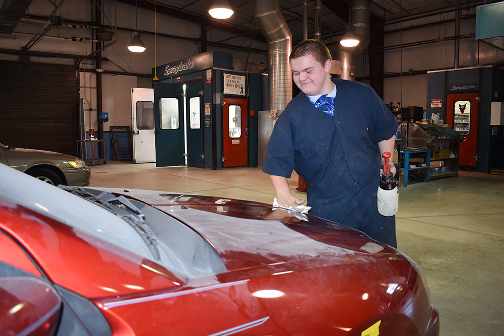 Antony Barnes demonstrated how to properly prepare a car to be refinished.