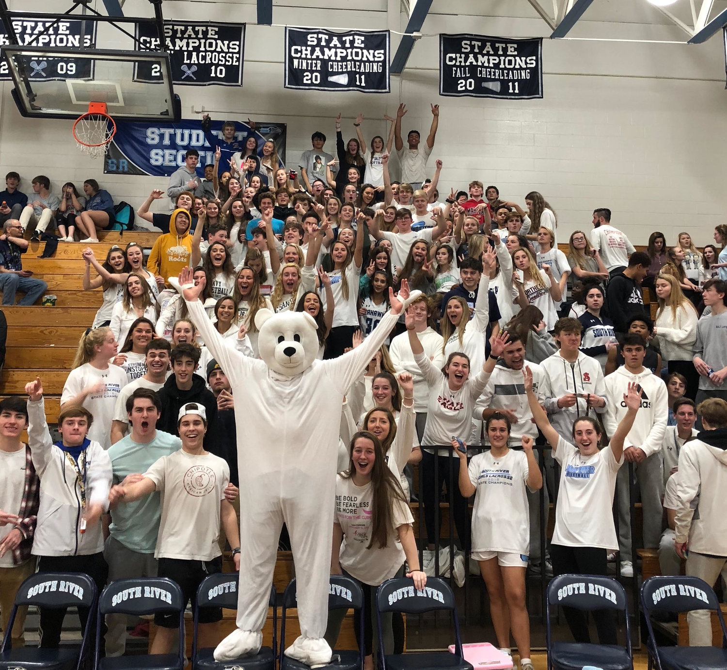 South River students wore white to a home basketball game against Southern to promote their fundraising efforts for the 24th annual Maryland State Police Polar Bear Plunge.