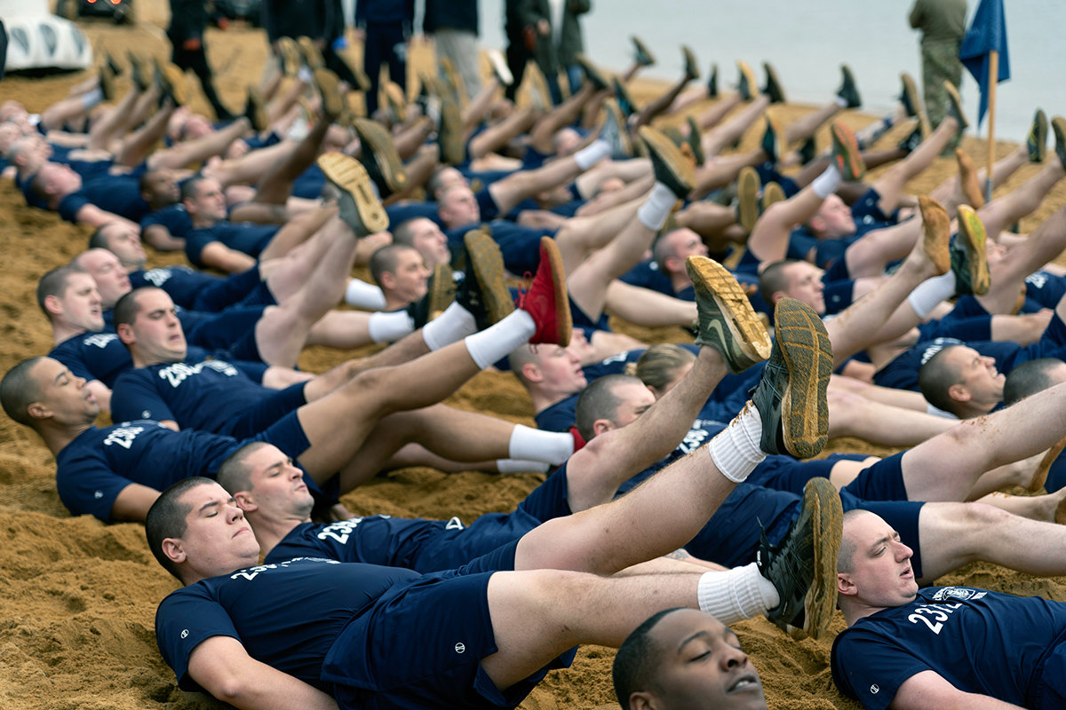 Cadets from the 90th Police Academy performed warm-up exercises in preparation for the Polar Bear Plunge.