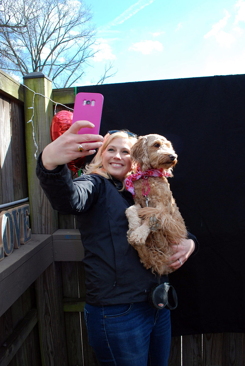 Liz Neunsinger posed with Pippa in the selfie booth.