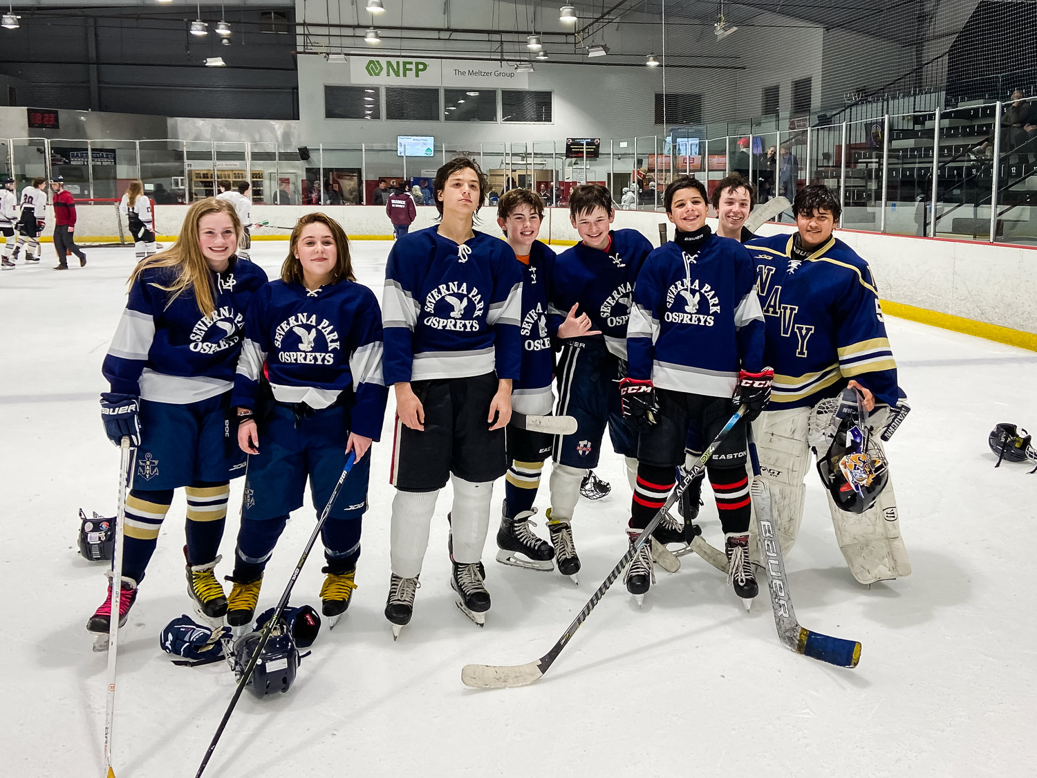 Severna Park Osprey eighth-graders (l-r) Mikaila Daly, Taylor Gruppuso, Luke Cobb, Dillon McConnell, Sam Testerman, Ryan Phelan, Sam Gillespie and Jagan Som completed their final season of middle school ice hockey this winter.