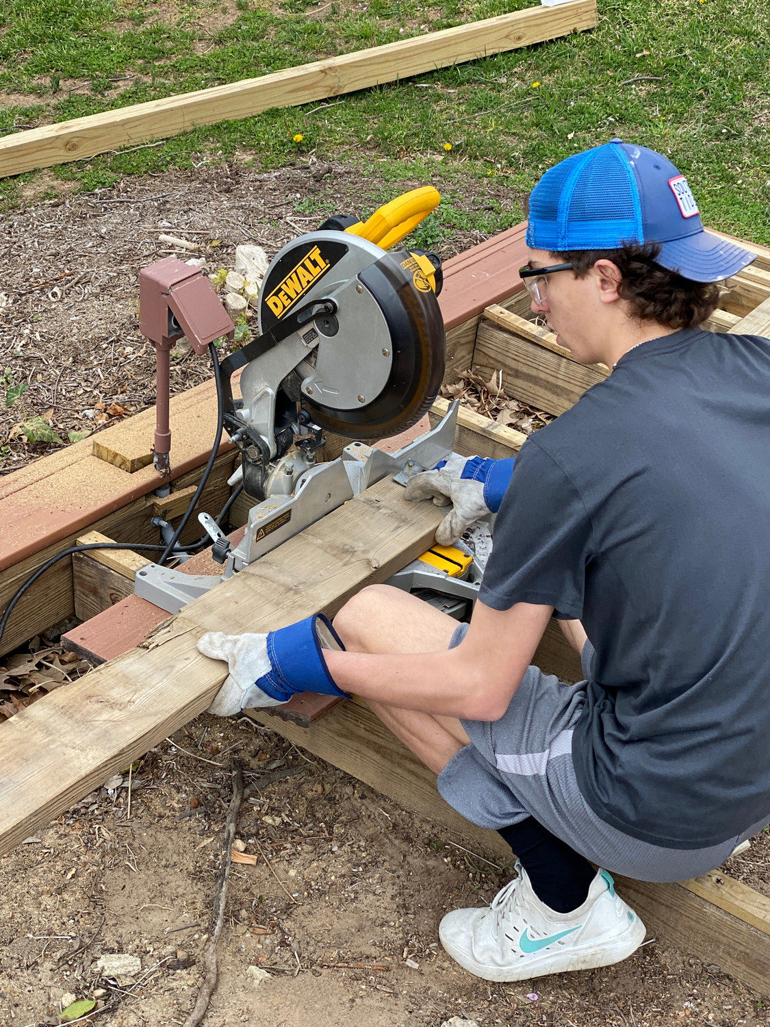 Without baseball practice every day, Archbishop Spalding senior pitcher Nick Schepens has been filling the time building garden beds as gifts for his neighbors.