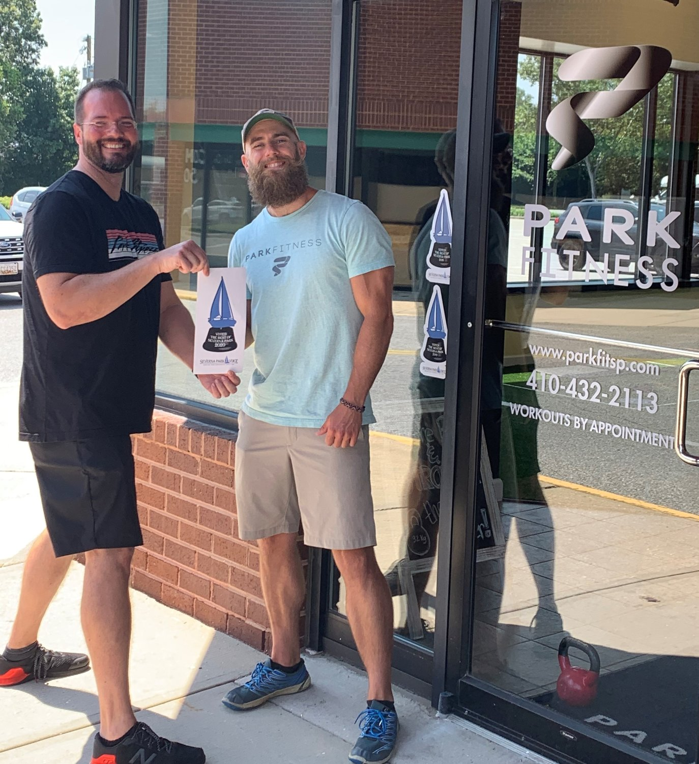 On behalf of Park Fitness, Joe Bocek (left) and Danny O'Malley accepted the Best Of award for Best Fitness Club, Best Weight Loss Program, and Best Overall Customer Service.