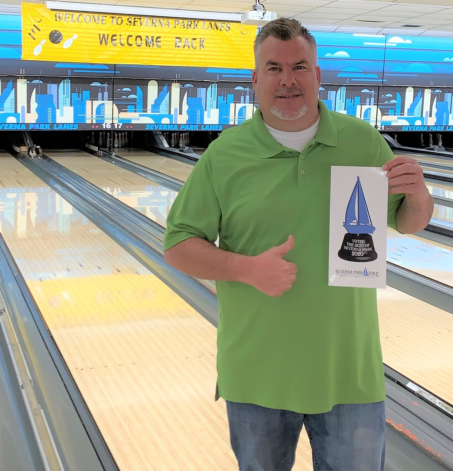 Severna Park Lanes owner Mike Hall accepted the Best Of award for Best Place For Family Entertainment.