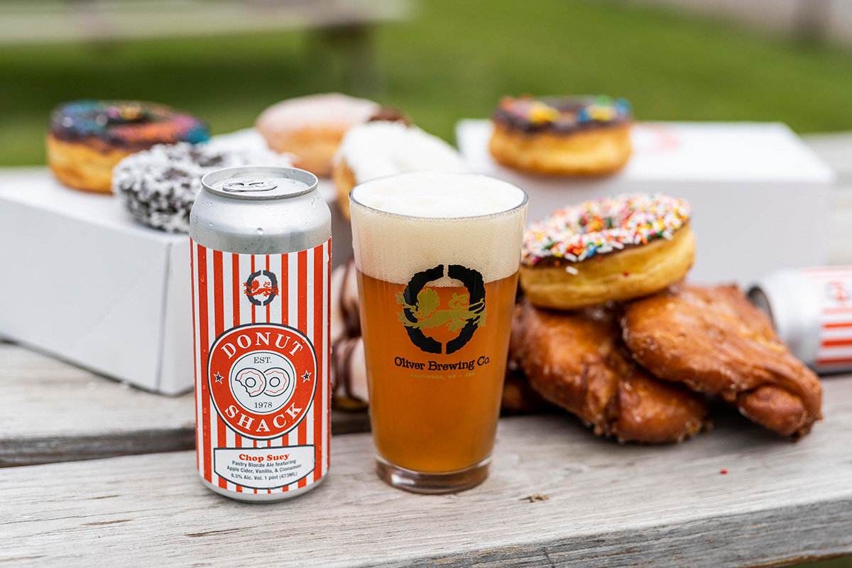 Based on Donut Shack's Chop Suey apple fritter, the new blonde ale – brewed with apple cider, vanilla and cinnamon – was created by Oliver Brewing Company.