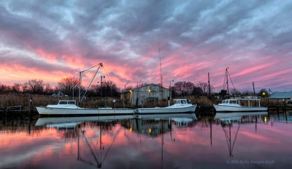 "Kim Kelly likes capturing images that depict the Chesapeake Bay. This photo is called ""Workboats at Dawn"""