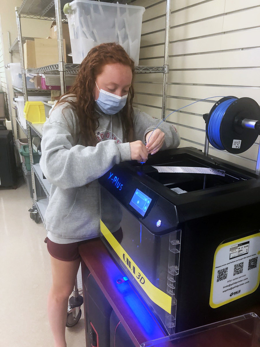 Regan King (pictured) consulted Stephanie Ebersole, coordinator in the Surgical Simulation Center at AAMC, who perfected the process of 3D printing the adaptors. Then King made a workshop in her basement, where she assembled and tested the devices.