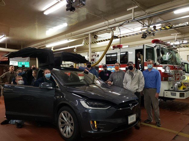 Firefighters examined a Tesla Model X, from Tesla of Baltimore, during a workshop on electric vehicle fires at Earleigh Heights Volunteer Fire Company.