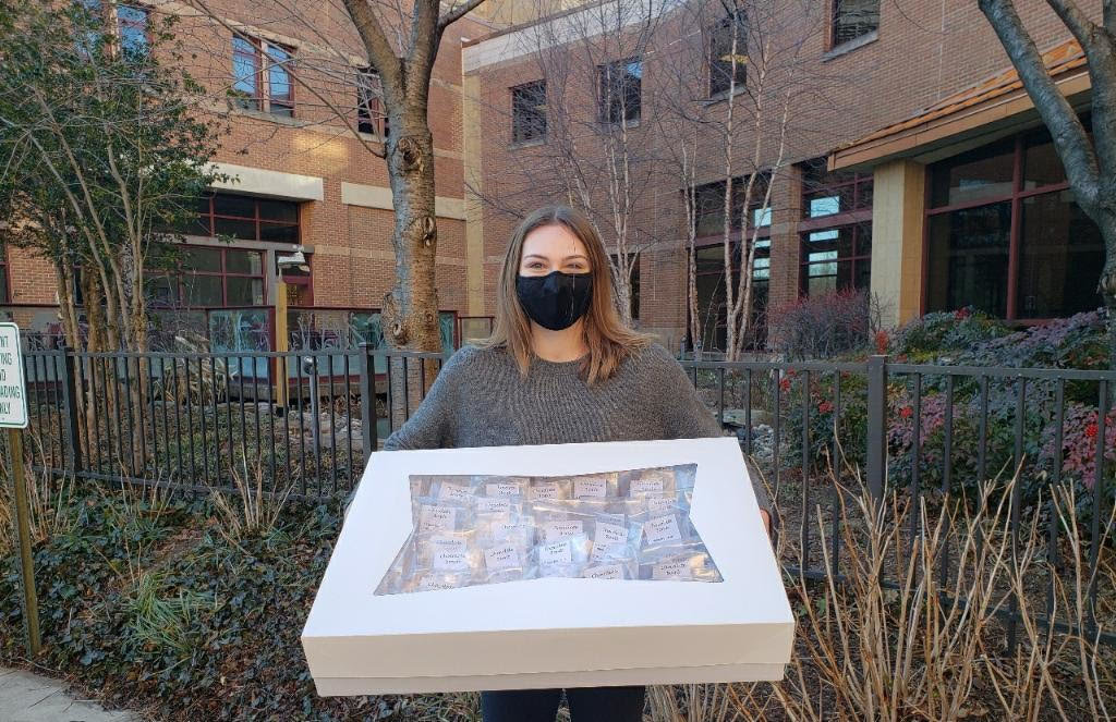 Kiley Curran stood outside Anne Arundel Medical Center with a box of coco bombs for critical care workers.