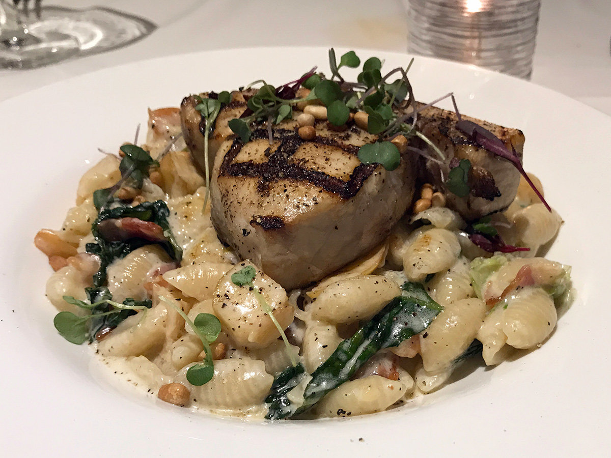 The swordfish Portofino paired a deep-sea briny taste with the smooth cavatelli pasta in a velvety parmesan cream sauce with apple, bacon, and toasted pine nuts.