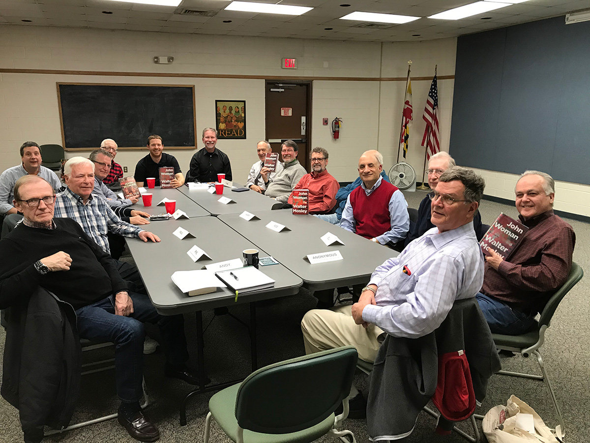 The Guys Book Club, pictured in one of the last meetings before the pandemic, is hosted by the Severna Park Library but is currently operating virtually.