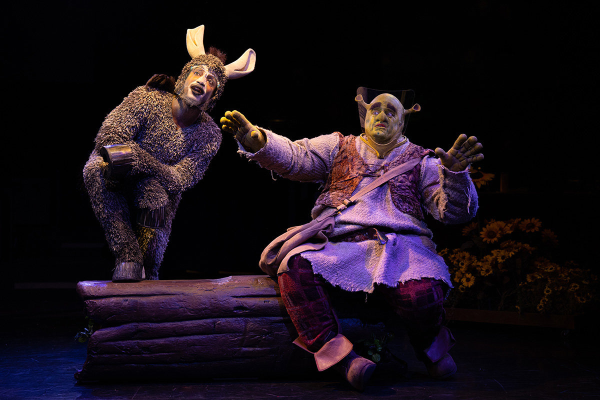 "Bryan Jeffrey (Donkey) and Russell Sunday (Shrek) star in the Toby's Dinner Theatre production of ""Shrek: The Musical,"" open now through June 13."