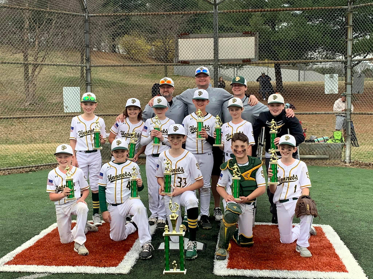 "The Knock the Rust Off tournament in March was won by the 11U team of (top row, l-r) coach Tim Delobe, head coach Tim Bowerman, coach Jim Viera, (middle row, l-r) Chase Goldman, Brody Smith, Brandon Matta, Drew Dupcak, Charlie Delobe, Campbell Jones, (front row, l-r) Tyson Viera, Nathan Peacock, Sebastian Kongas, Jonathan Bullough and Tyler Bowerman (not pictured are Brayden Kiernan, who was out of town, and Campbell ""Moose"" Jones, who was injured)."