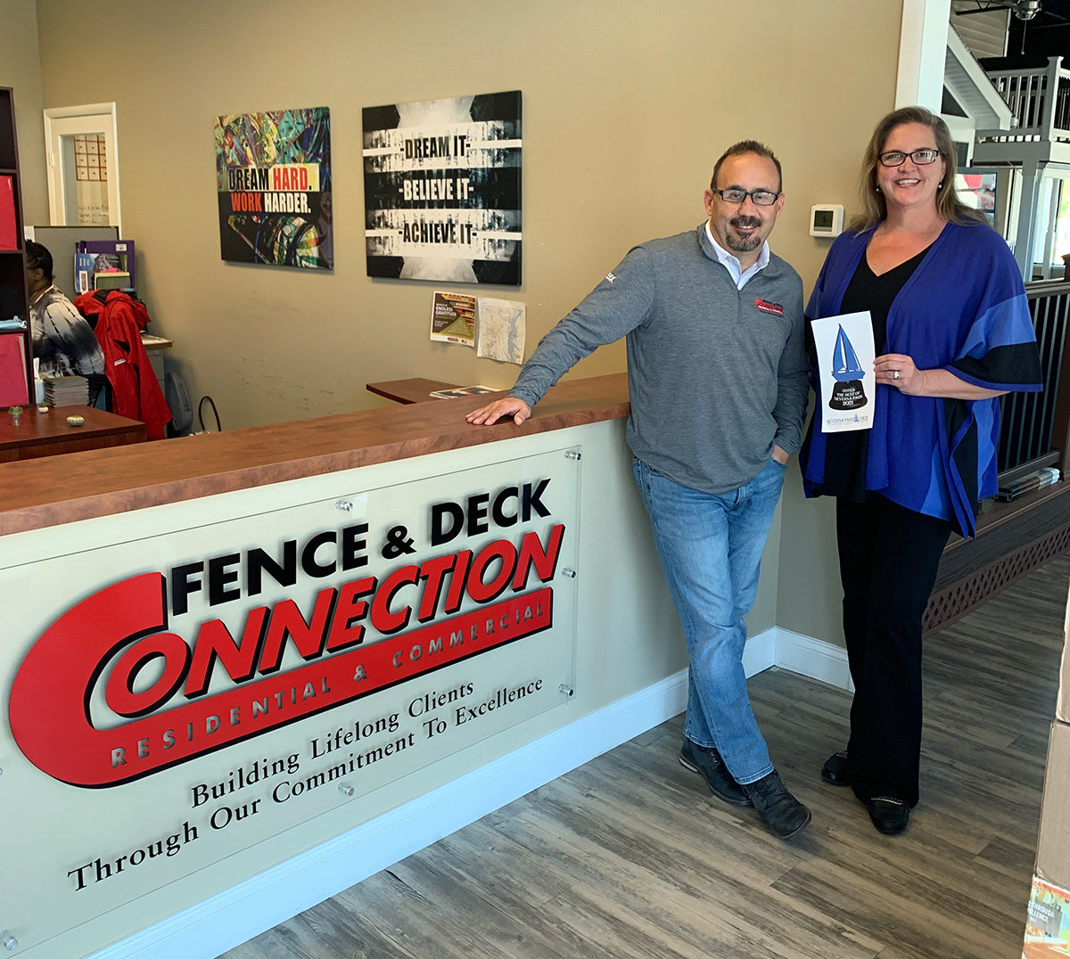 On behalf of Fence & Deck Connection, Jeffrey Wall and Sarah Ditto accepted the decal for Best Fence/Deck Contractor.