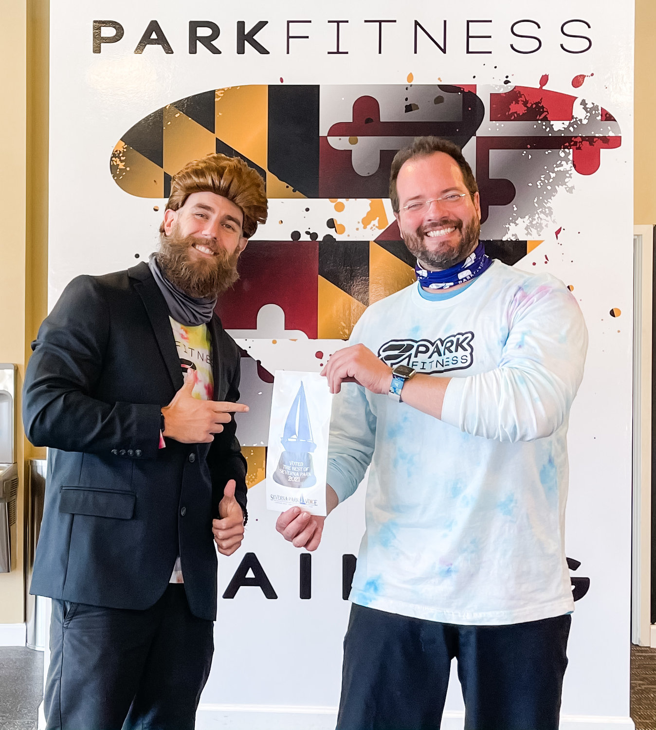 Park Fitness owners Danny O'Malley and Joe Bocek had fun showing off the decal for Best Fitness Club, Best Weight-Loss Program and Best Overall Customer Service.