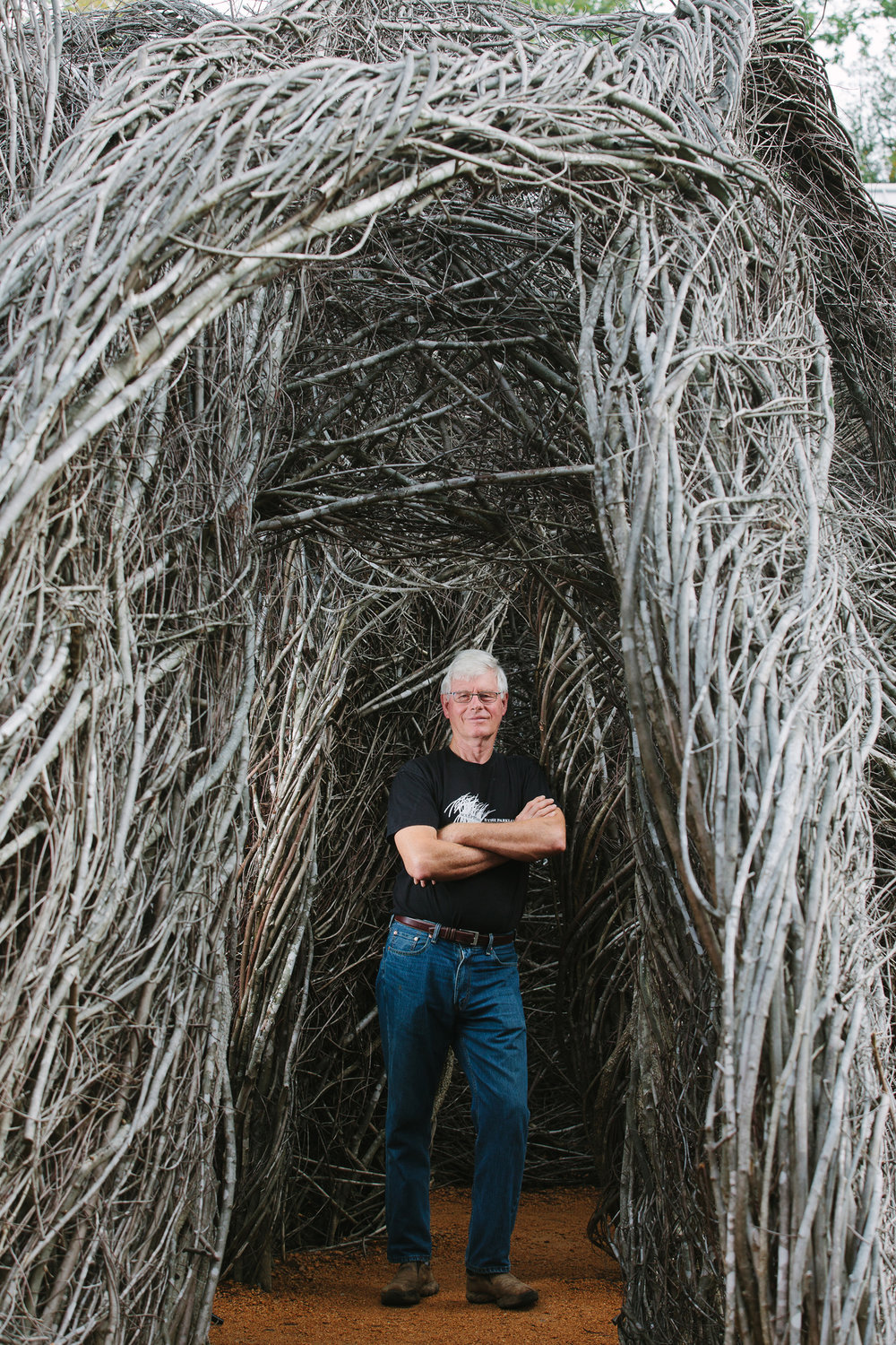 "Patrick Dougherty is seen here with ""Homegrown,"" his stick sculpture installation at the NC Botanical Gardens in Chapel Hill."