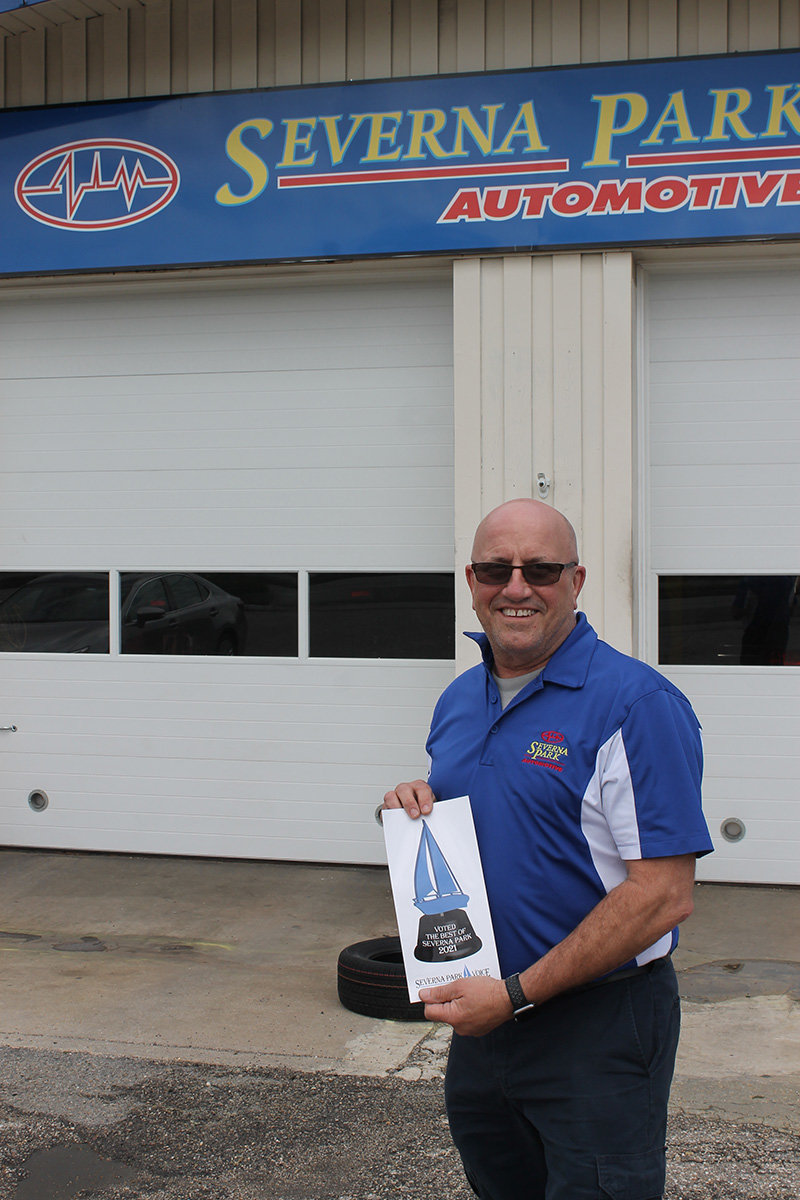 Mike McNealey from Severna Park Automotive was proud to display the decal for Best Auto Repair.