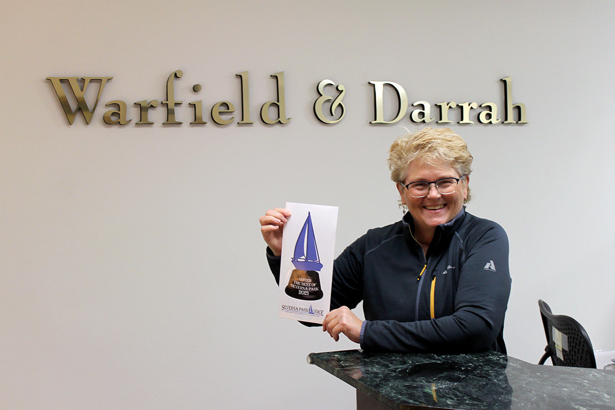 Paula Darrah of Warfield & Darrah, P.C. accepted the award for Best Lawyer.