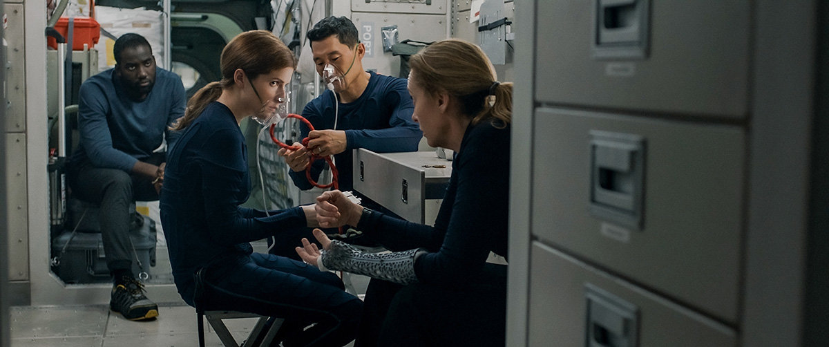 "The film's premise is simple: Commander Barnett (Toni Collette), Dr. Zoe Levenson (Anna Kendrick) and researcher David Kim (Daniel Dae Kim) are on a mission to Mars when they discover that an engineer has ""stowed away."""