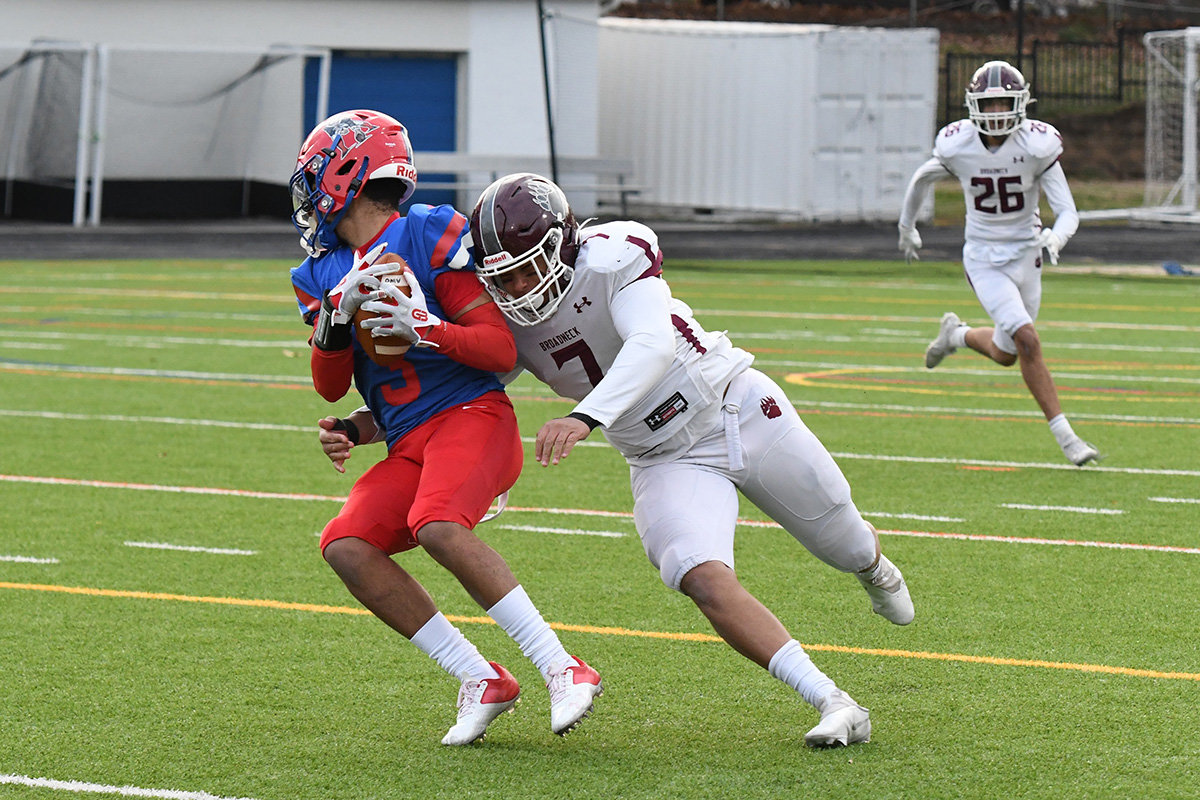 Junior Dom Downs was Broadneck's team captain on defense. Here, he made a tackle against Old Mill on April 1.