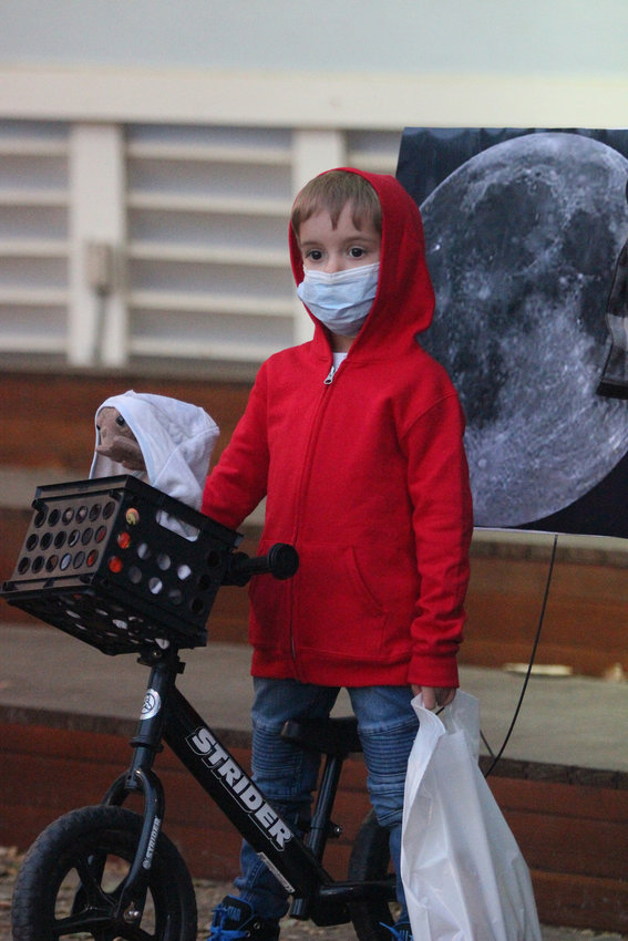 Oliver Elkins and his costume as Eliott from the film E.T., won the 4-year-old division of the Oct. 29 Halloween Costume Contest at the bandshell.