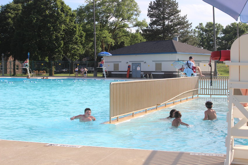 A group of swimmers move towards the shallow end of Dowding Municipal Pool on June 20.