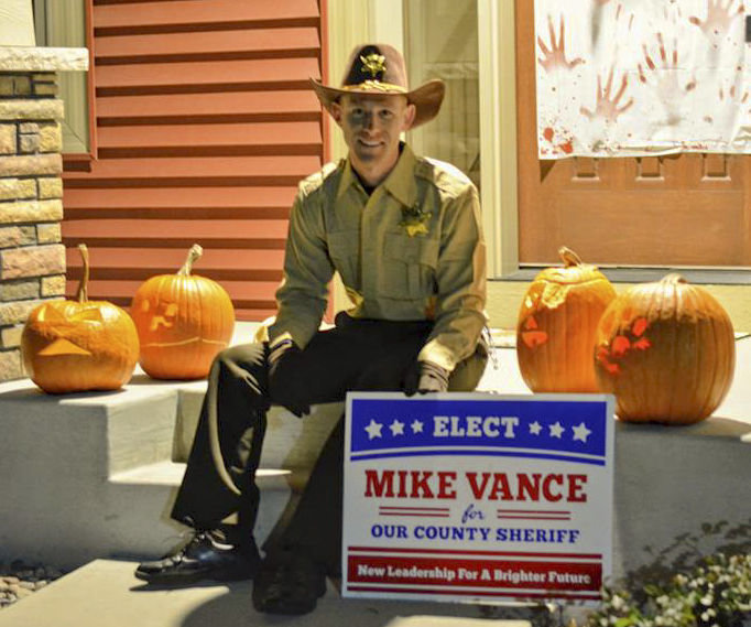 "Mike Vance of Rochester, Minnesota, embraced the ""Mike Vance for Sheriff"" campaign, dressing up as Sheriff Vance for Halloween after a campaign sign mysteriously appeared in his yard in September."